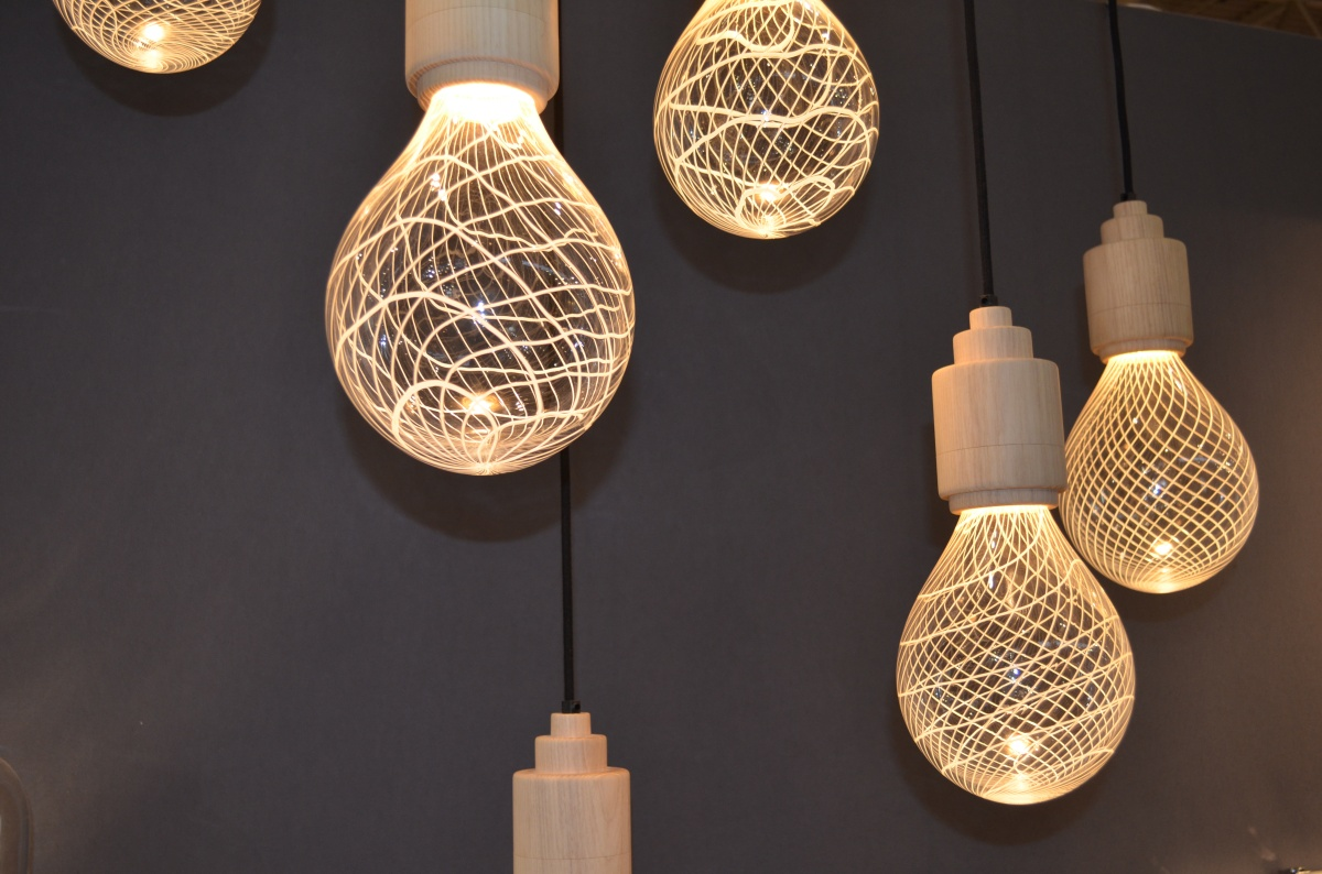 into lighting. The Lamps Have A Delicate Netted Pattern Developed From Spun Ghostly Lines  Onto The Clear Bulbous Shape. A Consistent, Uniformed Swirl And Rippled, Into Lighting L